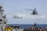 An Mh-60S Sea Hawk Picks Up Cargo from USNS Medgar Evers Photographic Print