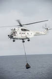 An SA-330 Puma Transport Helicopter Moves Cargo During a Vertical Replenishment Photographic Print