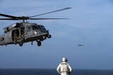 Sailor Watches an Air Force Hh-60G Pave Hawk Helicopter Prepare to Land Photographic Print