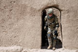 A Georgian Army Soldier Exits a Compound in Afghanistan Photographic Print
