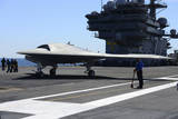 An X-47B Unmanned Combat Air System Aboard USS George H.W. Bush Photographic Print