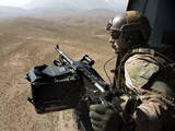 Door Gunner Scans the Terrain over Afghanistan Photographic Print