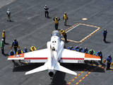 Sailors Push a T-45C Goshawk on the Flight Deck of USS Ronald Reagan Photographic Print