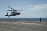 An Mh-60S Sea Hawk Prepares to Land on the Flight Deck of USS Nimitz Photographic Print