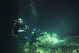 A Young Married Couple Scuba Diving in Devil's Den Springs Florida Photographic Print