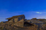 A Bright Bolide Meteor Breaking Up as it Enters the Atmosphere Photographic Print