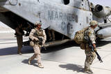 U.S. Marines and British Soldiers Exit a Ch-53E Super Stallion Photographic Print