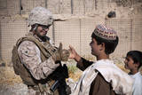 U.S. Marine Thumb Wrestles with an Afghan Boy Photographic Print