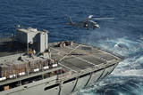 An Mh-60S Sea Hawk Conducts a Vertical Replenishment with USNS Rainier Photographic Print