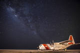 A U.S. Coast Guard C-130 Hercules Parked on the Tarmac on a Starry Night Photographic Print
