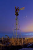 Venus and Jupiter are Visible Behind an Old Farm Water Pump Windmill, Alberta, Canada Photographic Print