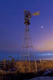 Venus and Jupiter are Visible Behind an Old Farm Water Pump Windmill, Alberta, Canada Photographic Print