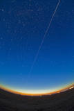 Trail of the International Space Station Coming Out of the Western Twilight Photographic Print