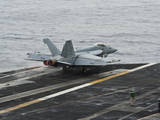 An F-A-18E Super Hornet Launches from the Flight Deck of USS Nimitz Photographic Print