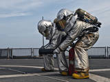 Technicians Check for Hot Spots During a Firefighting Drill Aboard USS Tortuga Photographic Print