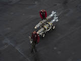 Marines Move Ordnance on the Flight Deck of USS Nimitz Photographic Print