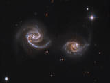 A Pair of Interacting Spiral Galaxies with Swirling Arms Photographic Print
