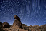 Star Trails Above a Granite Rock Formation in Cleveland National Forest, California Photographic Print
