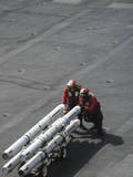 Ordnancemen Push Ordnance across the Flight Deck of USS Nimitz Photographic Print