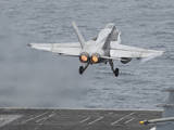 An F-A-18C Hornet Launches from the Flight Deck of USS Nimitz Photographic Print
