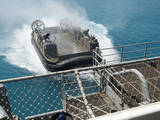 A Landing Craft Air Cushion Approaches the Well Deck of USS Bonhomme Richard Photographic Print