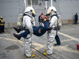Sailors Simulate Rescuing a Pilot During a Crash and Salvage Drill Photographic Print