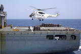 An SA-330J Puma Helicopter Delivers Supplies to USS Kearsarge Photographic Print