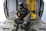 A Search and Rescue Swimmer Sits in the Back of an Mh-60S Sea Hawk Photographic Print