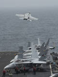 An F-A-18F Super Hornet Taking Off from USS Nimitz Photographic Print
