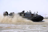 An Air-Cushion Landing Craft Approaches the Shore of Camp Al-Galail, Qatar Photographic Print