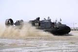 An Air-Cushion Landing Craft Approaches the Shore of Camp Al-Galail, Qatar Photographic Print