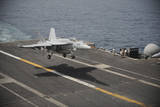 An F-A-18E Super Hornet Lands Aboard the Aircraft Carrier USS Nimitz Photographic Print