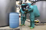 Cbrn Defense Specialists Check a Barrel for Contamination Photographic Print