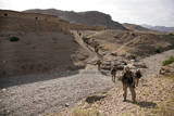 U.S. Marines Patrol Through a Village in Afghanistan Photographic Print