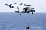 Mh-60S Sea Hawk Helicopters Conduct a Vertical Replenishment Photographic Print