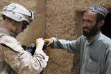 U.S. Marine Enrolls an Afghan into the Secure Electronic Enrollment Kit Photographic Print