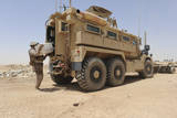 Hospital Corpsman Loads Up a Mine Resistant Ambush Protected Vehicle Photographic Print