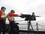 Aviation Ordnanceman Fires a .50-Caliber Machine Gun Photographic Print