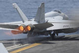 An F-A-18E Super Hornet Launches from USS Nimitz Photographic Print