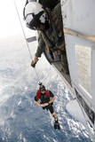 Aircrewman Assists in Hoisting a Member into an Mh-60S Sea Hawk Photographic Print