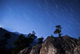 Whisps of Moonlight Shine Through the Mountain Peaks of Inyo National Forest Photographic Print
