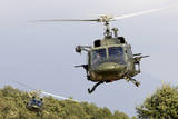 Two Italian Air Force Ab-212 Ico Helicopters Practice Low Level Flying Photographic Print