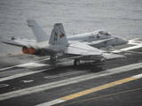 An F-A-18C Hornet Launches from the Aircraft Carrier USS Nimitz Photographic Print