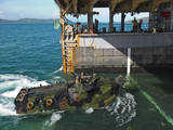 An Amphibious Assault Vehicle Enters the Well Deck of USS Tortuga Photographic Print