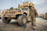 Airman Checks the Weight of a Vehicle in Afghanistan Photographic Print