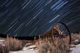 Abandoned Farm Equipment Against a Backdrop of Star Trails Photographic Print