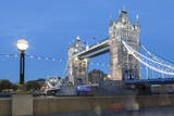 Tourists and Passers by Stop to Take Pictures of Tower Bridge at Dusk Photographic Print by Charlie Harding