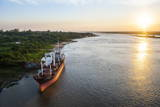 Cargo Boat at Sunset on the Asuncion River, Paraguay, South America Photographic Print by Michael Runkel