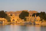 Jaisalmer Fortress and Gadsisar Lake Illuminated at Sunrise, Jaisalmer, Rajasthan, India, Asia Photographic Print by Douglas Pearson