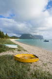 Little Boats Lying in the Grass in Front of Mount Lidgbird and Mount Gower in the Background Photographic Print by Michael Runkel